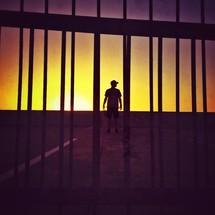 Man outdoors at sunset