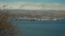 coastal town and snow capped mountains