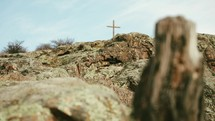 a cross at the top of a mountain