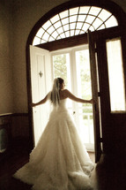 A bride opening the doors to walk outside