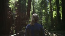 a woman exploring a forest trail