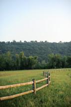 winding fence on farm land