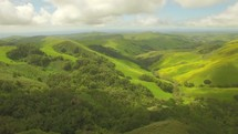 aerial view over green mountains and valleys