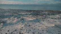 aerial view over a snow covered landscape