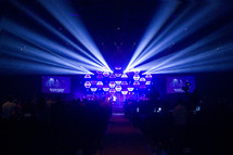 spotlights over a stage at concert