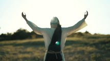 Jesus with hands raised worshiping God