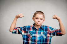 kid showing his muscles
