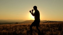 silhouette of a man boxing