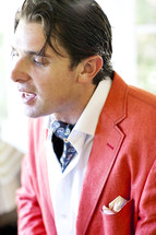 man in a red blazer
