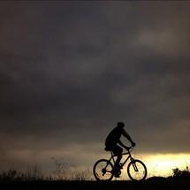 Man riding bike at sunset
