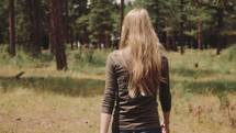 woman walking in a forest
