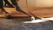 a man putting in wood flooring