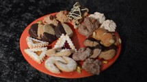 preparing a plate full of homemade christmas cookies for family and friends.