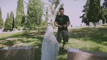 man standing in a graveyard