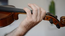 a man playing a violin