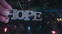 "Hanging ""hope"" ornament on Christmas tree 1 of 4"