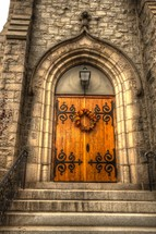 wreath on wood doors on a stone cathedral