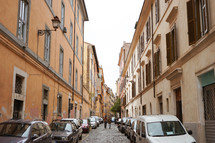 compact cars parked on a narrow street in Rome
