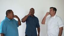 three men taking communion