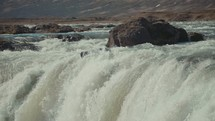 rushing water over a waterfall
