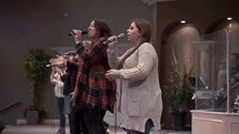worship leaders singing and leading a congregation in song