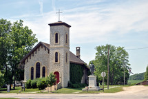 Small limestone country church shows beautiful architectural details in stonework and rafters.