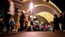 crowds of people at Disneyland at night