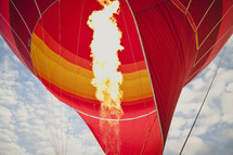 Fire blowing up inside of a hot air balloon