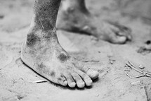 bare feet in the soil