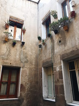 flower pots by windows on the exterior of buildings in Barcelona