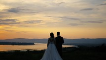 bride and groom at sunset
