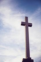 cross against clouds in sky