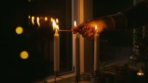 lighting candles with a match