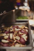 Potatoes served a la carte in a metal pan