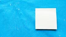 sticky note on blue