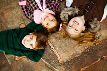 Kids lying down smiling