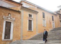a man walking down steps in Rome