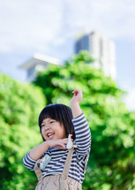 little girl playing outdoors