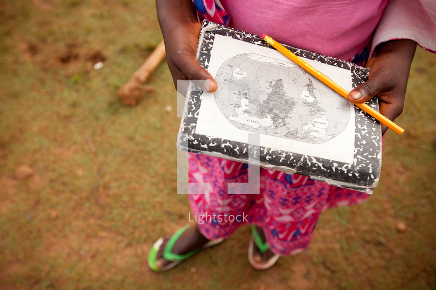 girl child holding a world map