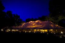 wedding reception tent canvas at dusk blue hour party event celebration