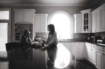 sisters sitting on a kitchen counter