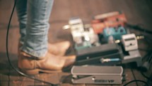 cowboy boots and guitar foot pedals