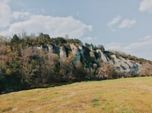 rock surface on a cliff and open meadow