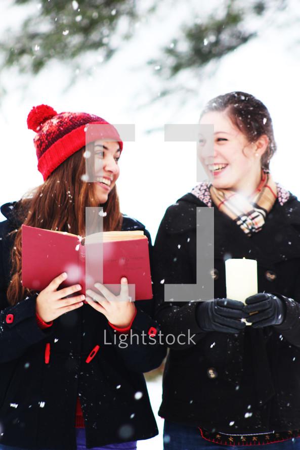 Christmas caroling in falling snow