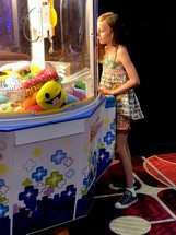a girl playing in an arcade