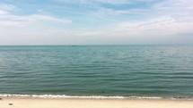 tide washing onto a shore Chesapeake Bay