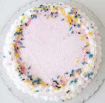icing and sprinkles on a cake