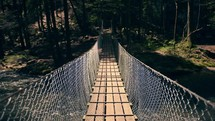 a swinging bridge over a river