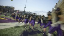 football players running onto the field