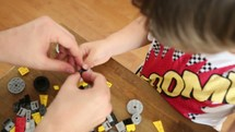 father and son building legos